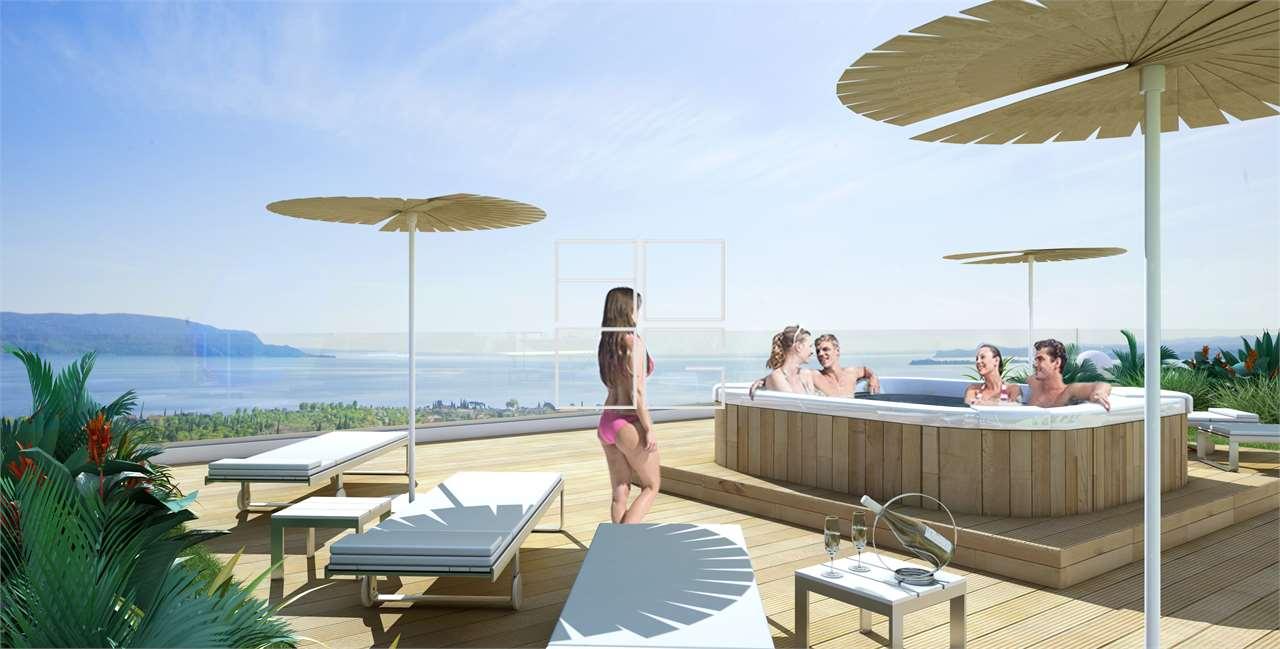 Prestigious lake view design penthouse in Toscolano Maderno